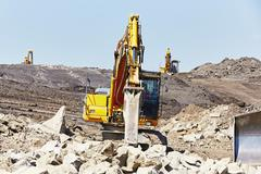 Excavators is working in the mine - selective focus - stock photo
