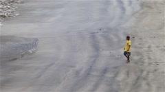 African boys walking on beach Stock Footage