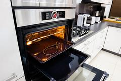 Modern hi-tek kitchen, oven with door open Stock Photos