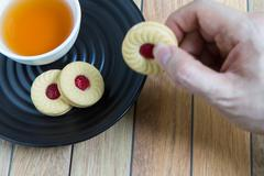 Homemade cookies filled with cranberry jam - stock photo