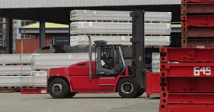 Forklift handling shipment at a busy industrial port. Stock Footage