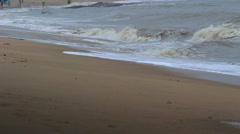 Waves patting on beach on an overcast day Stock Footage
