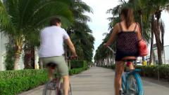 Couple cyclists at South Pointe Park of Miami Beach. - stock footage