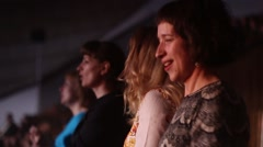 Happy girls dancing at a concert. Slow Motion. Lots of people dancing. Stock Footage