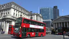 London buses passing in front of the Bank of England, London, UK. - stock footage