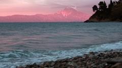 Beautiful sunset on Greece coast,Athos mount Stock Footage
