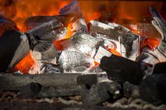 Burning wood Stock Photos