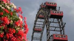 ULTRA HD 4K Prater Ferris wheel Vienna symbol red flower cabin motion turning  Stock Footage
