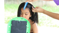 Asian children combing - stock footage