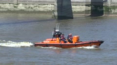 A RNLI lifeboat on the River Thames, London, UK. Stock Footage