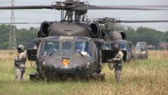 Blackhawk with Soldiers in Field Stock Footage