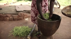 Woman cooking Africa village Stock Footage