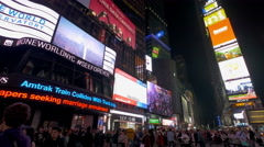 Commercial billboards and crowd on Times Square New York City at night Stock Footage