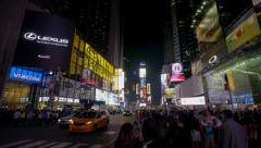 Commercial billboards and crowd on Times Square NYC, night shot, wide Stock Footage