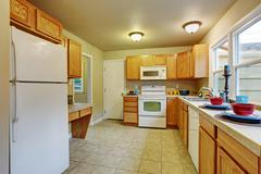 Authentic kitchen with tile floor. - stock photo