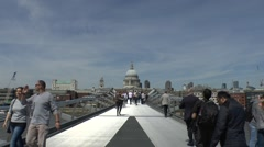 Stock Video Footage of St Pauls Cathedral viewed from the Millennium Bridge in London, UK.