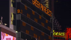 Stock Video Footage of Stock market ticker and advertisements at night