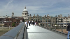 St Pauls Cathedral viewed from the Millennium Bridge in London, UK. - stock footage