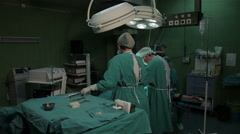 Surgical operation performed in the operating room. Surgery. Surgeons. Arkistovideo