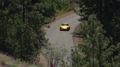 motorsports, hillclimb race, up close action follow shot, porsche 911 orange - stock footage