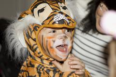 Young boy in a tiger costume at the masquerade. - stock photo