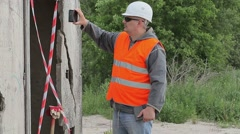Construction Engineer near building filmed with tablet PC Stock Footage