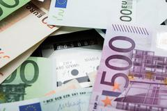 Close-up Of A Euro Banknotes Over Electricity Meter - stock photo