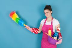 Woman as house wife - stock photo