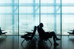 Woman in transit waiting on airport gate. - stock photo