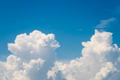 White Cumulonimbus Clouds On Blue Sky Stock Photos
