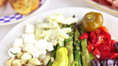 Stock Video Footage of Appetizers plate with vegetarian antipasto in Italian restaurant.