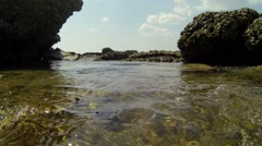 Water level rising and lowering in a tidal pool Stock Footage