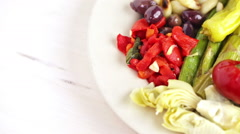 Appetizers plate with vegetarian antipasto in Italian restaurant. - stock footage