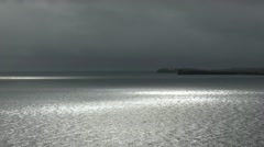 A ray of light flows over the entrance to Scapa Flow, Orkney Stock Footage