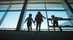 Three children ran to the window airport terminal Stock Footage