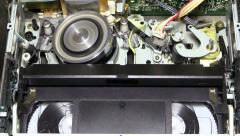 VHS recorder with tape showing inner workings with an insert and eject tape Stock Footage