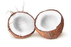 Two halves of coconut lying next Stock Photos