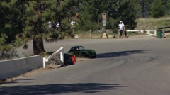 motorsports, hillclimb race, up close action follow shot, hillclimb green legend - stock footage