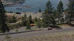 motorsports, hillclimb race, low angle on hill, orange Datsun 510 - stock footage