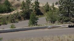 Motorsports, hillclimb race, low angle on hill, red black Subaru WRX Stock Footage