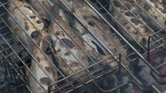 Grilled fish. Roaches. End of cooking. Stock Footage