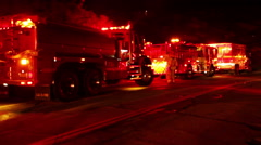 Fire vehicles on road night Stock Footage
