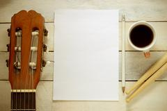 Inspirational background with a Spanish classical guitar on a wooden background Stock Photos