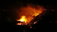 Wildfire flares firefighters ravine Stock Footage