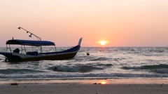 Fishing boat sway on sea waves, beautiful sunset, motorboat sweep by Stock Footage