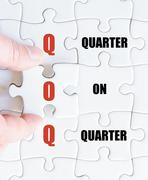 Hand of a business man completing the puzzle with the last missing piece - stock photo