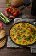 Mens omelette with chorizo - stock photo