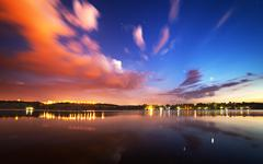 Beautiful night sky at the river with stars and clouds Stock Photos