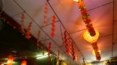 Red paper squares garland hanging under ceiling, chinese decoration Stock Footage