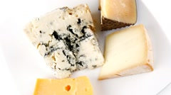Four type of delicatessen cheeses on plate Stock Footage